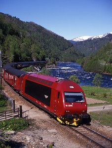 A final shot on the way back to catch the ferry in Bergen.  In stunning weather brand new 18.2245 hauls train 602 the 10.20 Bergen-Oslo at Skorve near Voss, 1/6/97