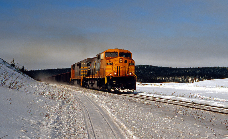 Further east at km 35 407 and 402 on a loaded train, the former another C44-9W, the latter a C40-8M
