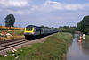 Further west, between Bedwyn and Crofton, a Penzance bound HST passing canal boats on the K&A
