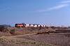 On March 22nd 60019 approaching the Ouse Washes on the Ely to Peak Forest RMC stone empties.