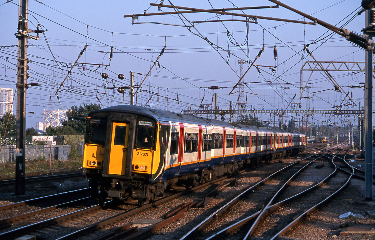One of the most impressive early post-privatisation liveries was that of WAGN applied to their class 317/6 EMUs. Seen here passing Alexandra palace on an early evening Peterborough commuter service.