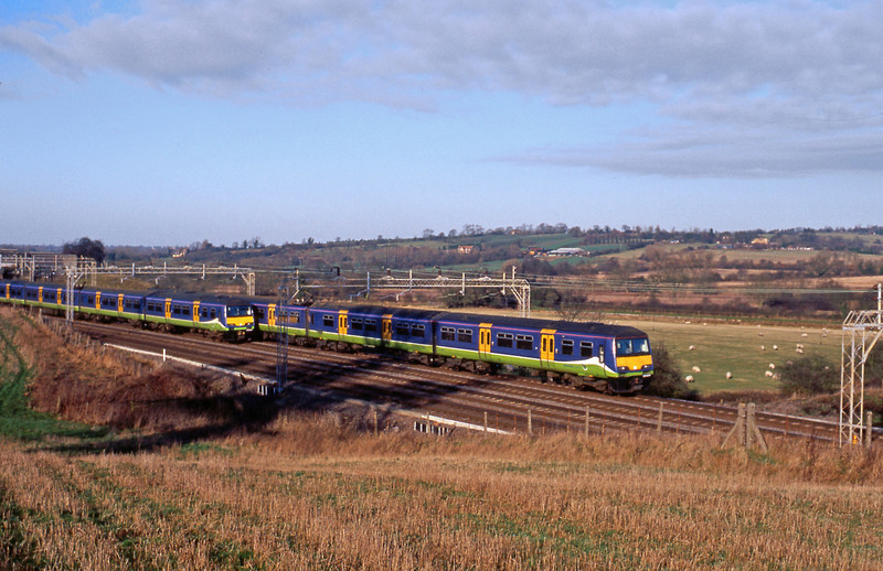 A pair of Silverlink 321s pass