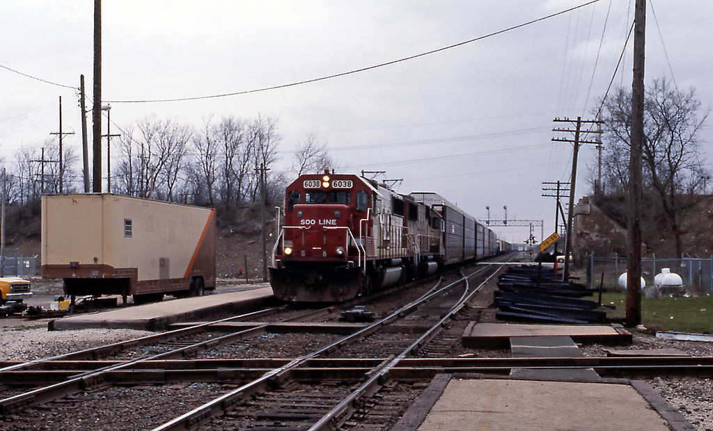 Easter Sunday. Before joining in the Easter Egg hunt in Naperville I spent the morning at Rondout, where the Soo Line (ex-Milwaukee Road) crosses the EJ&E, and where the Mundelein branch of the Chicago North Shore and Milwaukee interurban crossed the Milwaukee. A southbound Soo Line freight approaches the EJ&E crossing, passing the abutments of the CNS&M bridge.