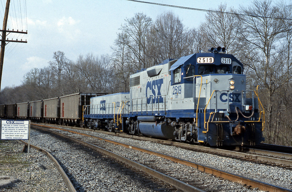 At the south end of the yard CSX 2519, a GP38-2 with slug 1021, a former B&O GP9, is switching coal hoppers.