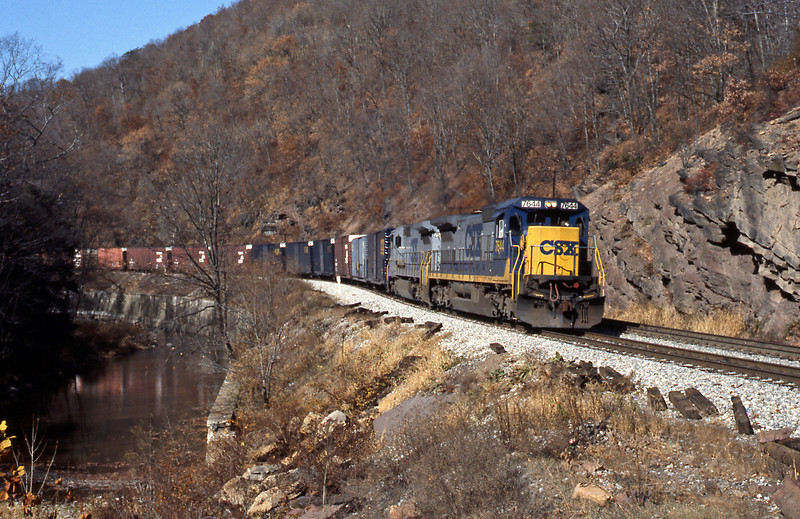 The first eastbound of the morning, formed of Hi Cube box cars which IIRC are used primarily by the auto industry moving parts between plants. Wills Creek was very low according to some railfans I met later on account of a very dry autumn. The revised CSX livery, with yellow and blue was much more attractive than the 'stealth' grey scheme. 7644 is a six axle GE C40-8