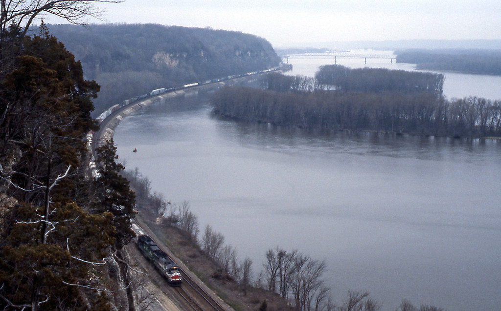 I spent the night in Dubuque, IA - which actually is on the West Bank of the Mississippi. Day 9 found me on the top of the palisades above the river with the BN mainline to the Twin Cities and the Pacific Northwest just below. The light was pretty dreadful. A leased LMX B39-8 is on the head end.