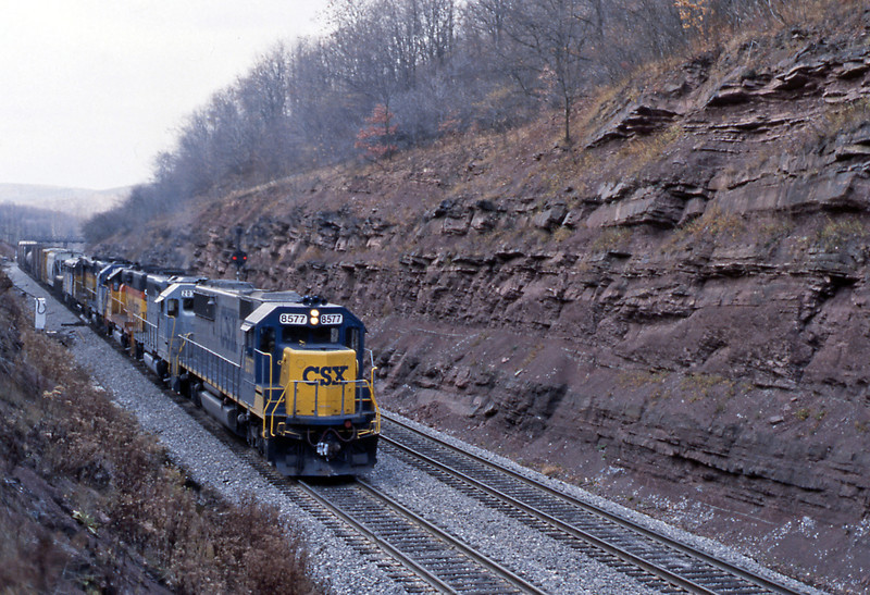 A mixed freight accelerates downhill towards the west portal of the tunnel. I didn't realise just what an interesting consist was in store. 8577 upfront is an SD50. But look what's behind...