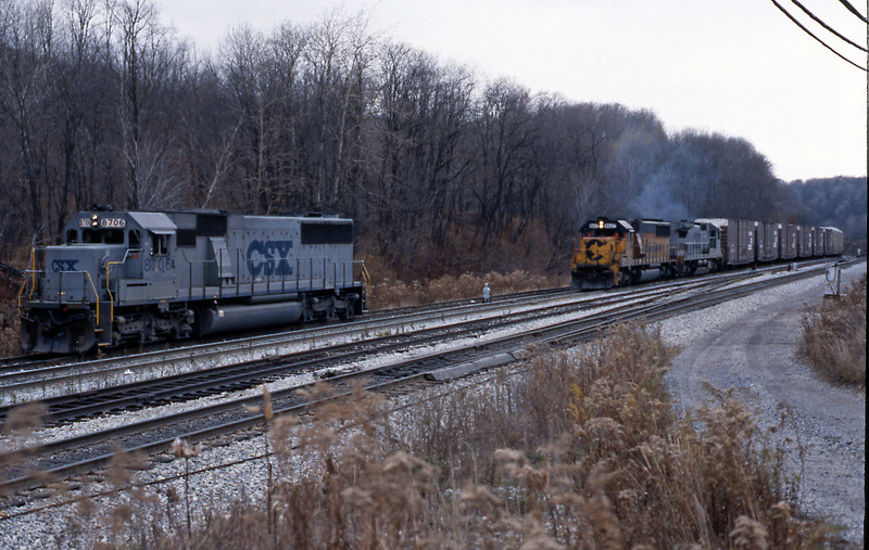 Day 8 and my last day on the B&O, I have to be back in Altoona later to catch the Broadway Ltd back to Chicago. Up at Sandpatch and one of the SD60 helpers is in the siding, whilst a westbound of hi cube box cars and autoracks headed by an SD50-2 struggles over the summit.