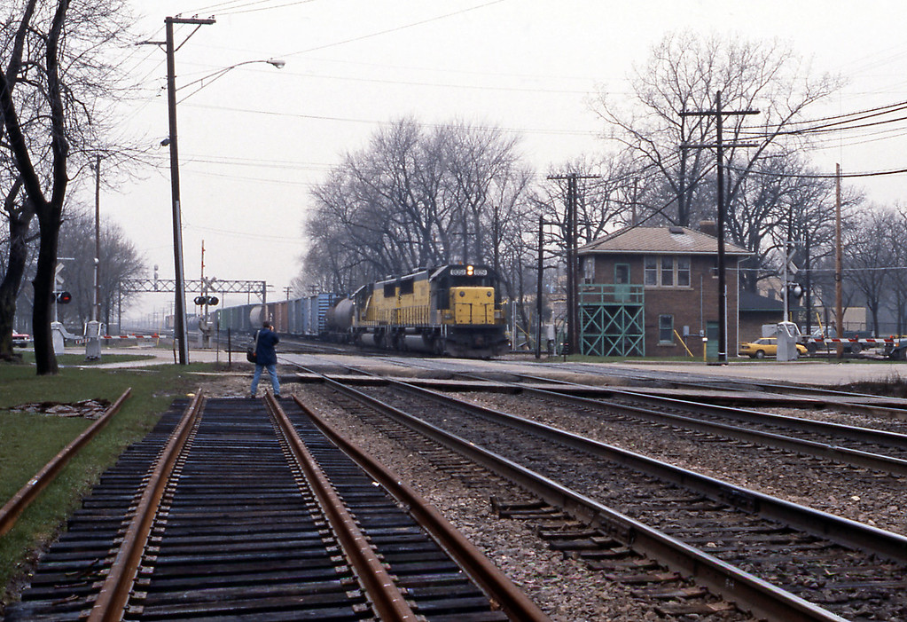 West Chicago is where the Elgin, Joliet & Eastern crosses the CNW, hence the signal tower. Mel gets closer to 8051, an SD60.