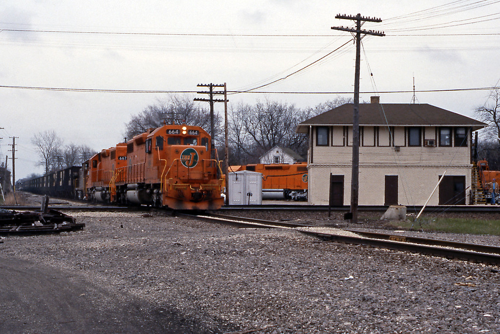 They had to get out of the way to allow this empty westbound unit coal train past, presumably from a power plant on the shores of Lake Michigan near Waukegan. Today the EJ&E has been absorbed by the expansionist Canadian National