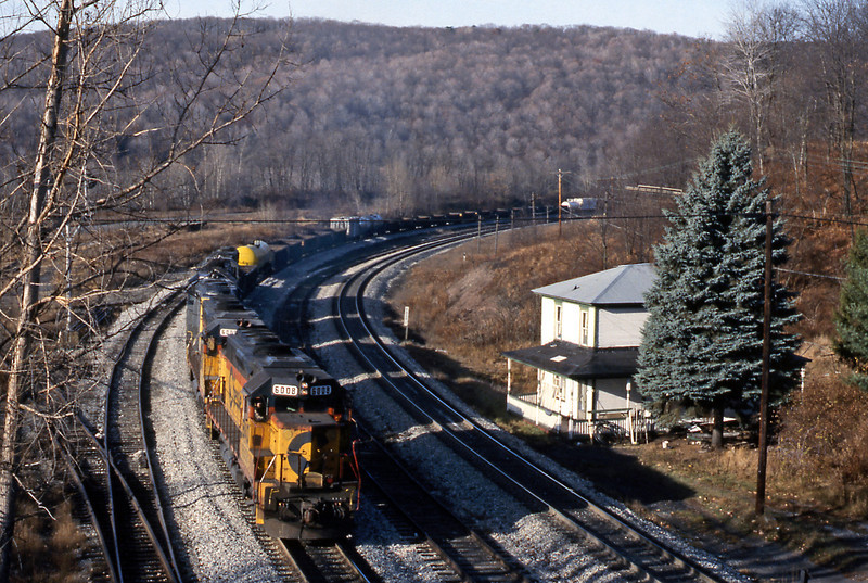 Having picked up the gondola the locos reassemble the train and prepare to head east. I decided not to follow it but to head west to Meyersdale and beyond towards Connellsville. 6008 is a GP40-2. That house looks ideal for a railfan.