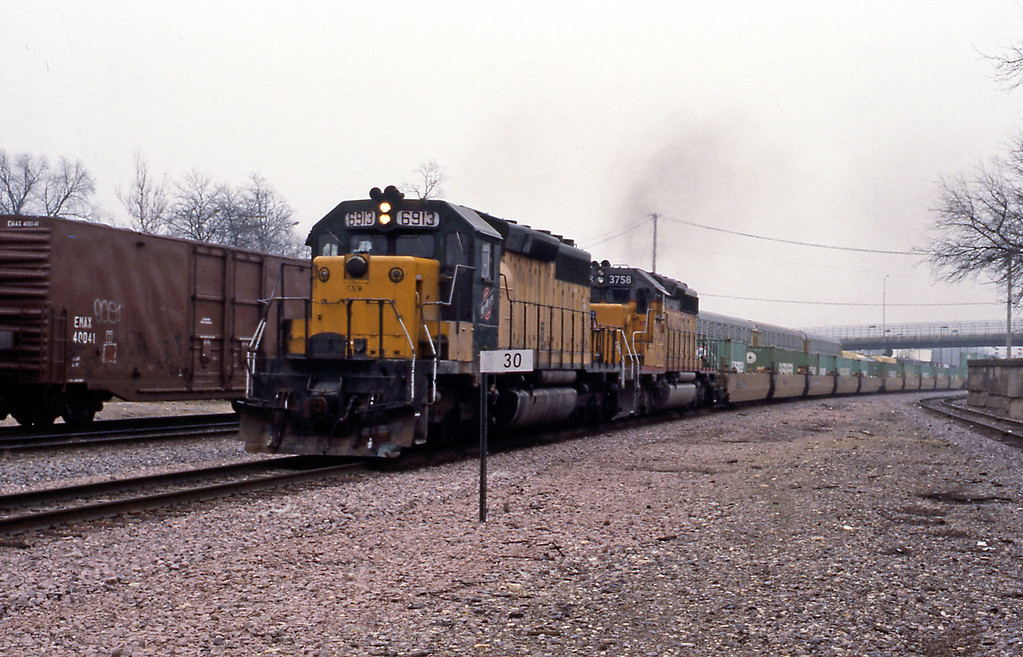 6913 an SD40-2 on a double stack.