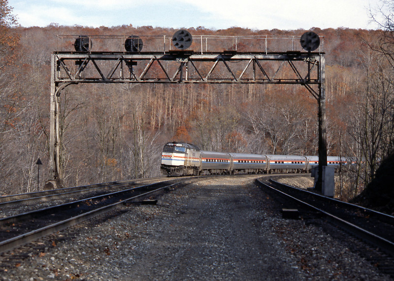 Under one of the Pennsylvania Railroad's characteristic position light signal gantries the Pittsburgh bound Pennsylvanian climbs towards Horseshoe Curve. After this picture I drove to Gallitzin for some pictures from above summit tunnel. Unfortunately neither are really very good :-(