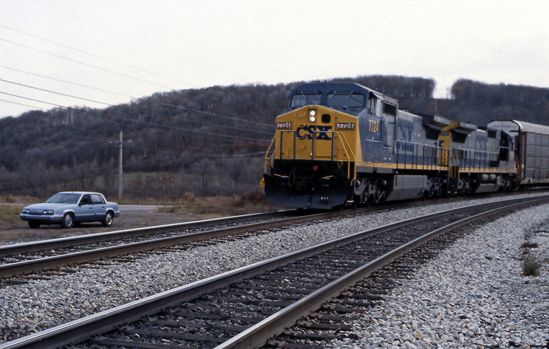 Another westbound headed by a pair of C40-8W passing my Oldsmobile Cutlass Calais.