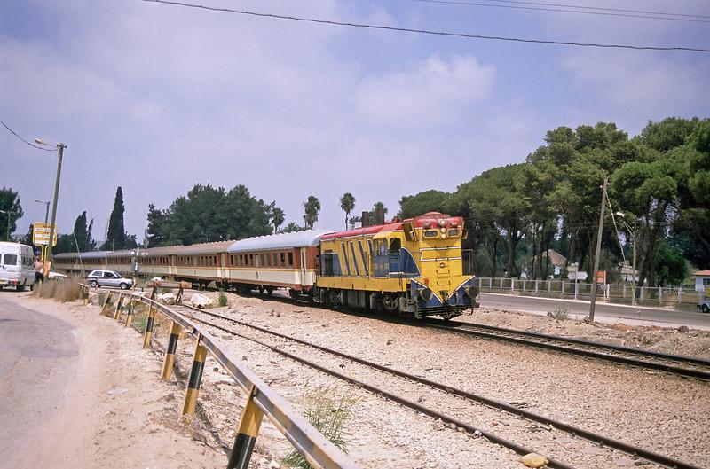 A Tel Aviv train drifting in to Binyamina behind G12 104 of 1954.