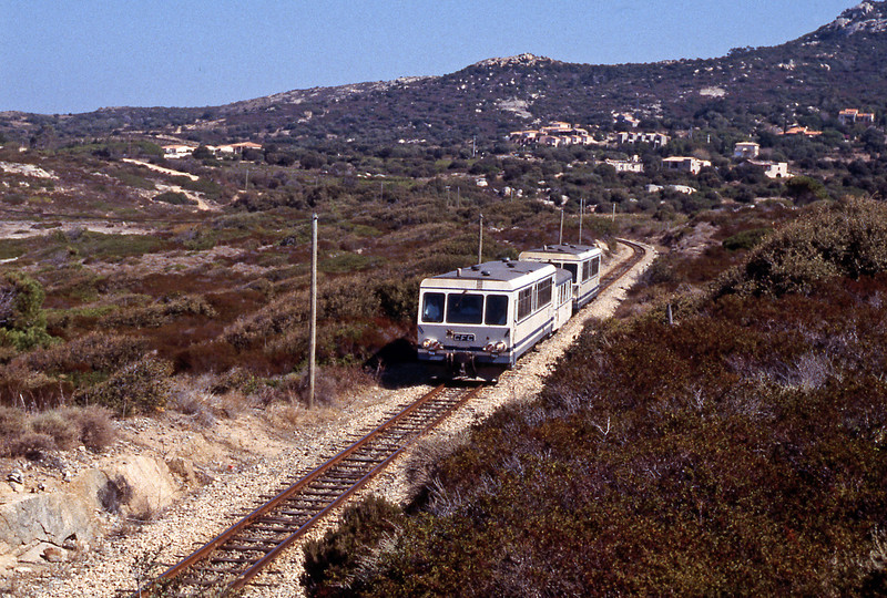 A Bastia to Calvi train formed of a pair of X2000 railcars sandwiching a Billard trailer which was being used for luggage.