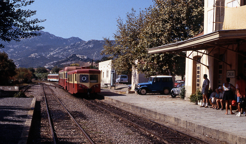 Calvi station was very typical of a French secondary railway. This railcar and trailer set is in the traditional blood and custard livery witn another Renault ABH8 in the yard beyond in the Paul Arzens designed SNCF livery.