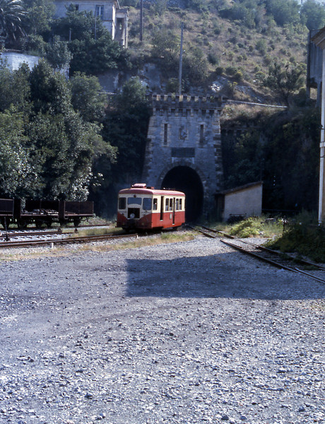 A railcar emerges from the tunnel and enters Bastia station on a suburban service from Biguglia