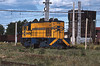 In the Temuco freight yard a small D-5100 class GE switcher was idling.
