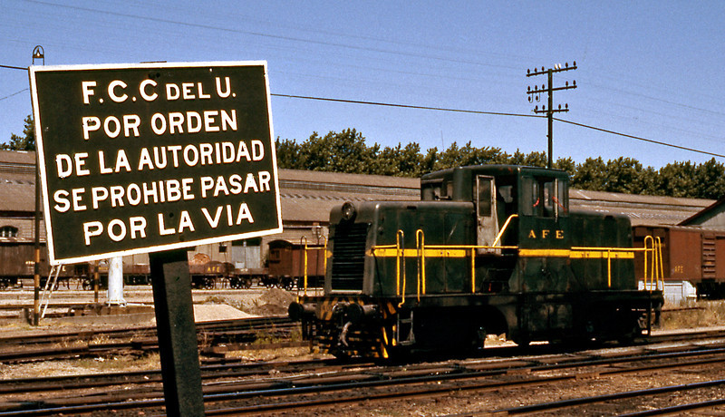 A small GE 44 ton switcher resting in the yard next to Central Station. The sign is quite self explanatory