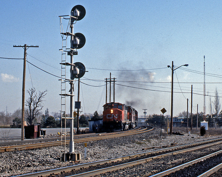 Burlington West is the site of the junction where CN's freight route meets VIA's passenger line from Toronto Union Station. A westbound appeared headed by a GP40-2LW...