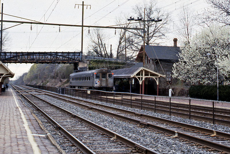 In the opposite direction a Silverliner II on a Paoli local makes a stop at Villanova.