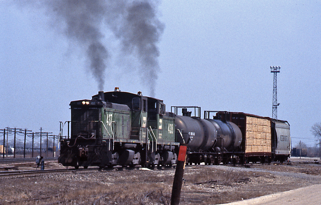 Mel and I drove to Eola Yard, between Naperville and Aurora, where this pair of SW1000s were smoking it up switching loads.