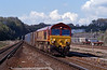 66077 racing through Micheldever on the 11:35 Mountfield to Southampton Docks gypsum containers.