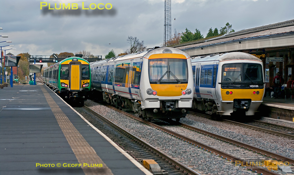 All three tracks through the station at Princes Risborough are occupied by northbound trains! On the left is London Midland 172 221 and 172 332 with 5Z02 from High Wycombe to Dorridge, this had stopped in the platform line to allow a non-stop Chiltern service to overtake it, operated by 168 215 in the centre, this is the 12:37 from Marylebone to Birmingham Moor Street. The 172 units could not be put in the centre road to allow this as a southbound service used the line a couple of minutes earlier... On the right is 165 026, working the 12:13 from Marylebone to Banbury. This arrives at Princes Risborough at 12:57 and is scheduled into the down platform, from where it departs at 13:10. 13:09, Friday 4th November 2011. Digital Image No. GMPI10557.