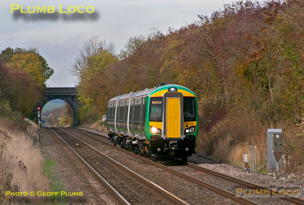 """London Midland 172/3 unit No. 172 332 is well """"off piste"""" as it runs some mileage accumulation workings, running as 5Z00 from Derby to Banbury. It then continued as 5Z01, 12:22 from Banbury to High Wycombe over the Chiltern line, returning as 5Z02 from High Wycombe to Dorridge, then 5Z03 back to Banbury and finally 5Z04 from Banbury to Derby. This is the 5Z01 section, approaching Haddenham & Thame Parkway station at 12:43, a few minutes early on Wednesday 2nd November 2011. Digital Image No. GMPI10491."""
