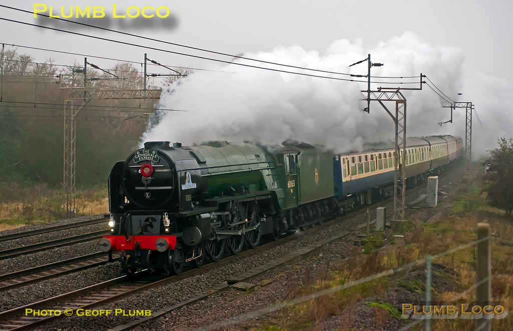 "A1 4-6-2 No. 60163 ""Tornado"" is working south along the up slow line at Old Linslade with 1Z72 ""The Cathedrals Express"", 08:15 from Northampton to Canterbury and return. The loco is carrying a Remembrance Wreath as the train ran on Friday November 11th 2011, sadly in foul weather. It is running a few minutes late at this point at 08:50. Digital Image No. GMPI10566."
