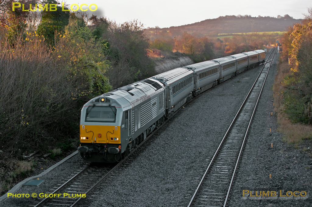"""With the road already set for it to crossover, 67015 """"David J. Lloyd"""" did not stop approaching Princes Risborough with 5A98, the 06:36 ECS working from Wembley LMD to Aylesbury DMUD for wheelset attention on the coaches of set AL03. This departed south from Wembley via Neasden Junction, Acton Wells, Acton Main Line and Greenford in order to turn the set as 67s are not allowed inside the depot building at Aylesbury due to their axle loading. 08:32, Friday 25th November 2011. Digital Image No. GMPI10660."""
