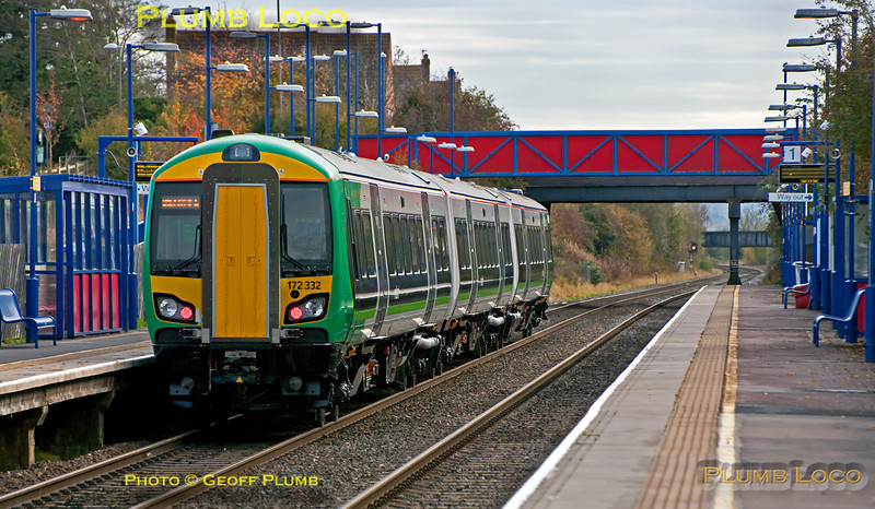 """London Midland 172/3 unit No. 172 332 is well """"off piste"""" as it runs some mileage accumulation workings, running as 5Z00 from Derby to Banbury. It then continued as 5Z01, 12:22 from Banbury to High Wycombe over the Chiltern line, returning as 5Z02 from High Wycombe to Dorridge, then 5Z03 back to Banbury and finally 5Z04 from Banbury to Derby. This is the 5Z01 section, passing through Haddenham & Thame Parkway station at 12:43, a few minutes early on Wednesday 2nd November 2011. Digital Image No. GMPI10501."""