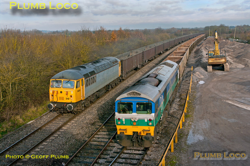 """Mendip Rail 59005 """"Kenneth J. Painter"""" stands at the Oxford Banbury Road stone terminal after unloading and waiting departure time as 7C54, the 13:06 empties to Whatley as DCR 56312 passes with 6Z91, the 10:55 empty fly ash train from Calvert to Didcot Power Station. 12:25, Friday 30th November 2012. Digital Image No. GMPI12963."""