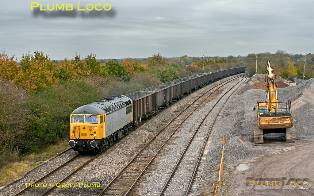 Running around twenty minutes late, DCR 56312 is passing Banbury Road stone terminal at Water Eaton, North Oxford, with 6Z91, the 10:55 empty flyash train from Calvert to Didcot Power Station. Work is likely to commence here soon for the new Chiltern Water Eaton Parkway station as part of the Evergreen Three upgrade for Marylebone to Oxford services. 12:41, Tuesday 6th November 2012. Digital Image No. GMPI12834.