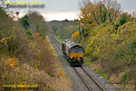 "DBS 66017 is working 6A49, the 12:10 trip working from Didcot Yard to MoD Bicester, with just one van in tow, approaching the tunnel at Wolvercote, on the former line from Oxford to Cambridge, at 12:37 on Wednesday 14th November 2012. In the distance on the left a Virgin ""CrossCountry"" hot air balloon takes to the skies! Digital Image No. GMPI12899."
