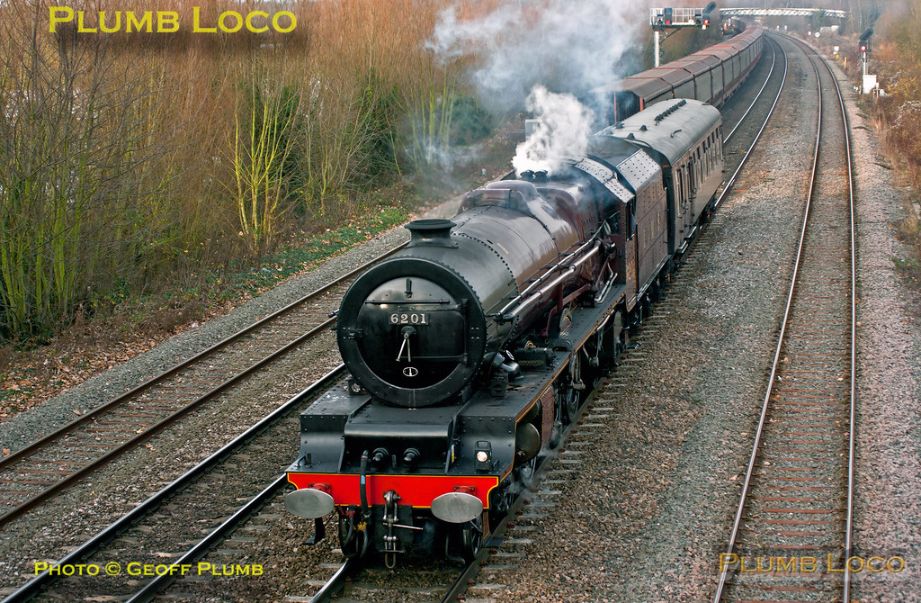 "LMS Stanier ""Princess Royal"" class 4-6-2 No. 6201 ""Princess Elizabeth"" is working just with its support coach in tow as 5Z70, 10:45 from Tyseley Loco Works to Southall, prior to the following day's trip to Worcester. It has just restarted from a signal stop at Oxford North Junction at 13:42 and heads south in weak sunshine, just as 66066 heads north with 6M48, Southampton Eastern Docks to Halewood empty car carrier - a very long train...  Friday 30th November 2012. Digital Image No. GMPI12992."