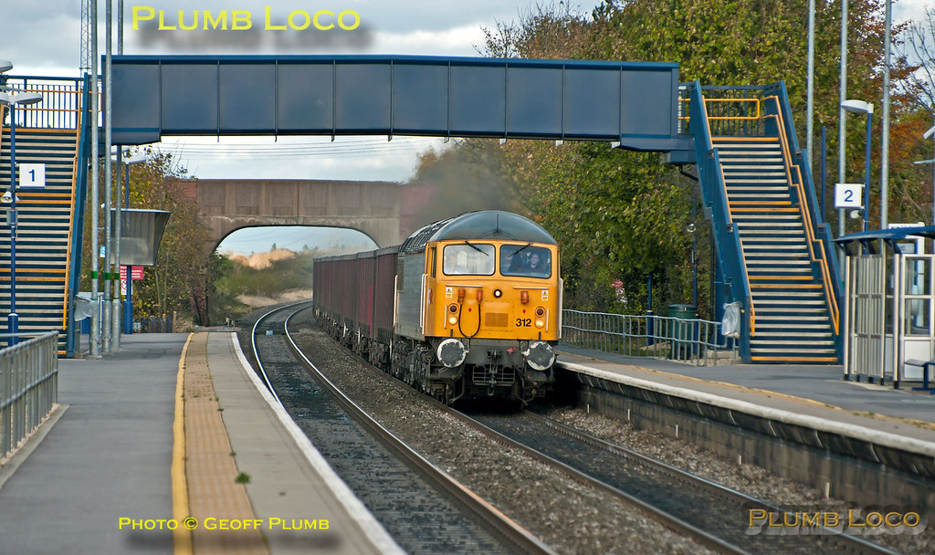 DCR 56312 at the head of 6Z91 once again, the 10:55 empty fly ash train from Calvert to Didcot Power Station, seen passing through Radley station at 12:28 on Thursday 8th November 2012. Digital Image No. GMPI12877.