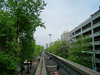 """Monorail on """"speedway,"""" headed for the Space Needle."""