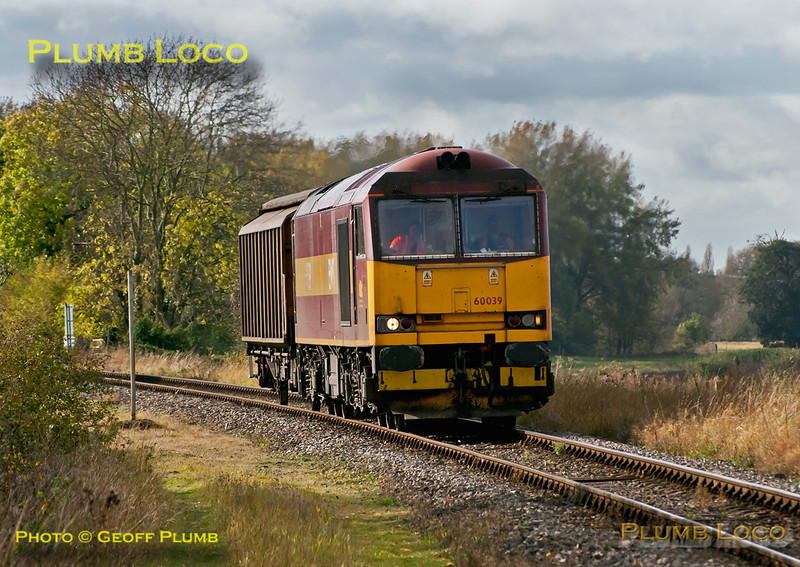 60039 provides exotic superpower on 6A49, the 12:10 from Didcot Yard to MoD Bicester with just one van in tow, here approaching the level-crossing at Islip at 12:36 on Wednesday 26th October 2011. Digital Image No. GMPI10421.