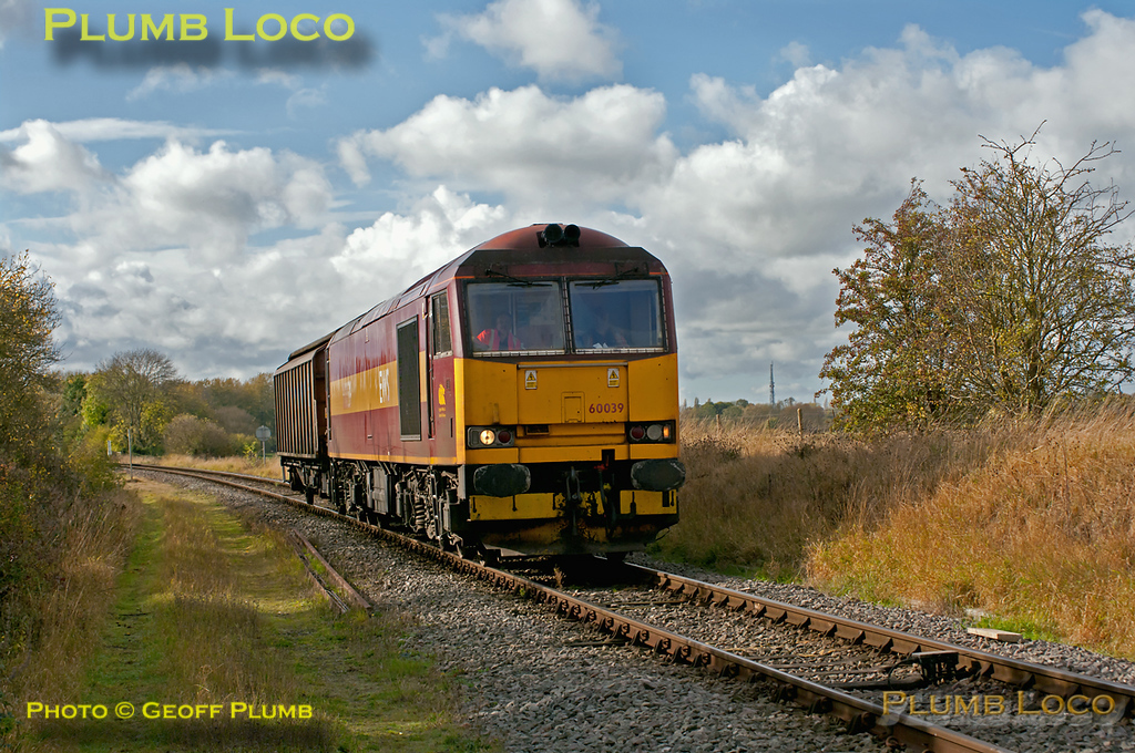 60039 provides exotic superpower on 6A49, the 12:10 from Didcot Yard to MoD Bicester with just one van in tow, here approaching the level-crossing at Islip at 12:36 on Wednesday 26th October 2011. Digital Image No. GMPI10427.