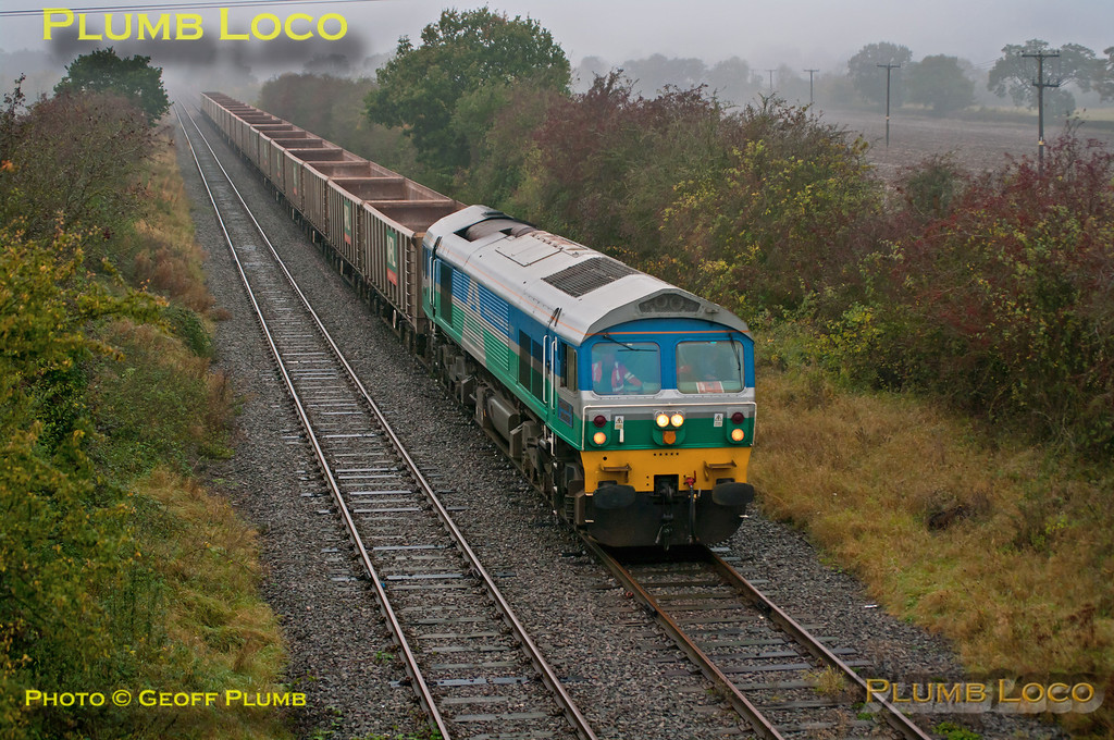 "Mendip Rail 59005 ""Kenneth J. Painter"" brightens up the misty, wet gloom as it pulls into the runround loop at Claydon L&NE Junction with 6Z61, 11:05 from Calvert to Merehead Quarry empty stone train, 11:13, Tuesday 23rd October 2012. After the loco ran round the train departed for Oxford and beyond at 11:31. Digital Image No. GMPI12715."