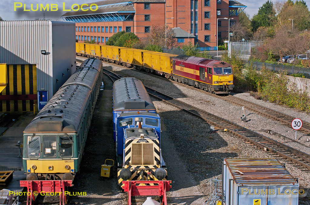 """With both 6A58 and 6V49 scheduled to leave Calvert at the same time, 10:14 to Northolt and Thorney Mill respectively, it was something of a gamble as to which train turned up! In the event, 6A58 won the toss and is seen here passing Aylesbury Depot at 10:54 with 60045 """"The Permanent Way Institution"""" in charge, the first time a Class 60 has been around these parts for ages. The loco also carries a 40B (Immingham) shed allocation plate. On the left in the foreground is the """"Green Goddess"""" Class 117 Sandite Unit No. 960 301, alongside """"Bubblecar"""" 121 020 and Ruston Shunter """"Lesley"""". Tuesday 30th October 2012. Digital Image No. GMPI12751."""