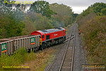 59203 was once again doing the honours with 7Z60 from Merehead Quarry to Calvert on Friday 19th October 2012, this time in miserable weather. Its return as 7Z61 was apparently retimed from 11:05 depart Calvert to 10:35 depart, but in the event it didn't leave until 11:41, with six of its twenty wagons still loaded. The loco makes a smoky start away from the unloading area, heading for the runround in the loop at Claydon L&NE Junction, the groundstaff shunter having set the points. Digital Image No. GMPI12636.