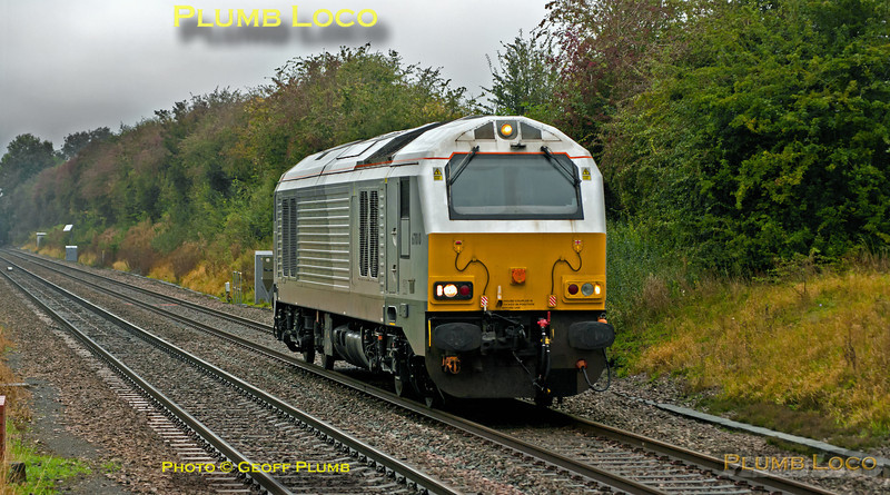 """On a wet and miserable Monday 8th October 2012, former WSMR 67010 returned from Crewe IEMD to Wembley LMD running as 0Z10, 09:55 from Crewe, to take up its place with Chiltern Railways. It had been out of action since before the demise of Wrexham & Shropshire (who had possible plans to name the loco """"Charles Darwin""""), so it was good to see it again on """"home turf"""" as it approaches Haddenham & Thame Parkway station at 13:43. Digital Image No. GMPI12523."""