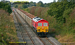 Although this train was supposed to run from Monday 15th October 2012 for several days, it ran for the first time on Thursday 18th October 2012. The outward working was 7Z60, 02:28 from Merehead Quarry to Calvert, with arrival due at 06:30. 59203 is now working the return train, 7Z61, 11:05 from Calvert to Merehead, easing along the loop at Claydon L&NE Junction before running round, 11:19. Five of the twenty JNA wagons are still loaded, there not having been enough time to unload them all... Digital Image No. GMPI12602.