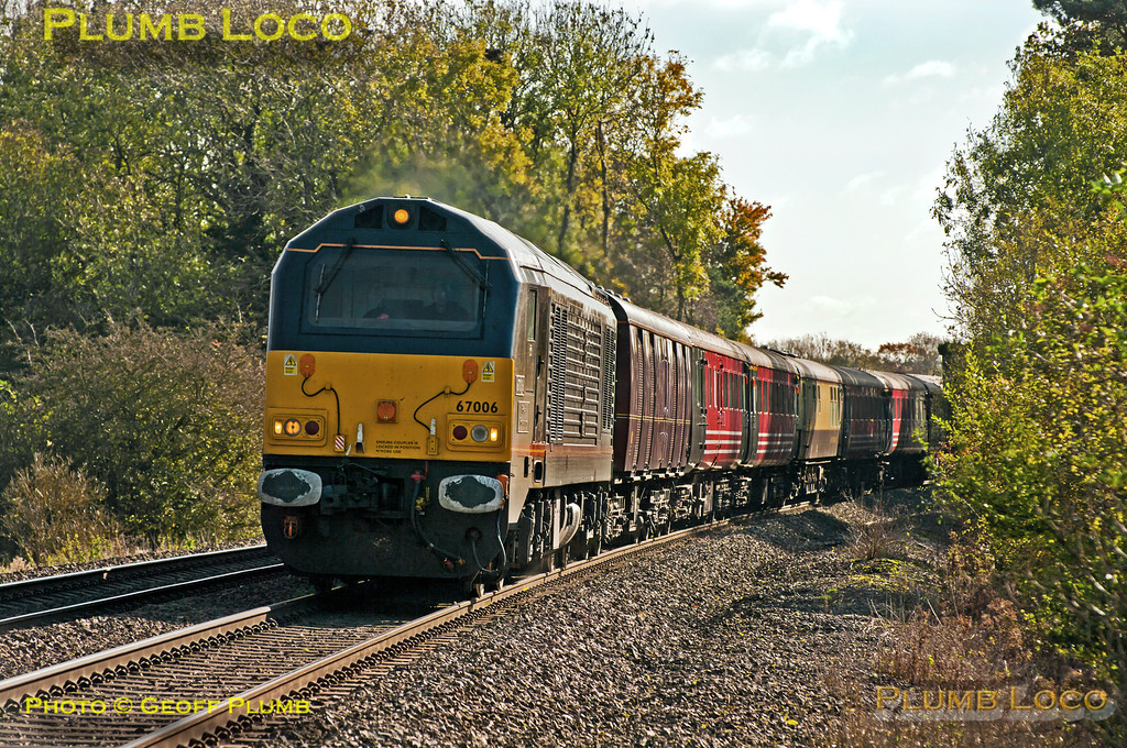 """""""Royal"""" Class 67 No. 67006 """"Royal Sovereign"""" at the head of 1Z23, the 10:05 from Southampton Western Docks to Glasgow Central boat train, at Wormleighton (just south of Fenny Compton) at 12:21 on Saturday 27th October 2012. This is usually a DRS working with Class 47s and """"The Great Briton"""" set of coaches, but on this occasion was a DBS 67 and a motley set of ex-Virgin and other coaches! Digital Image No. GMPI12736. Thanks to Mark Miller for pointing out this train is actually a separate working from the DRS operated Cruisesaver and is a DBS working for Barrhead Travel..."""