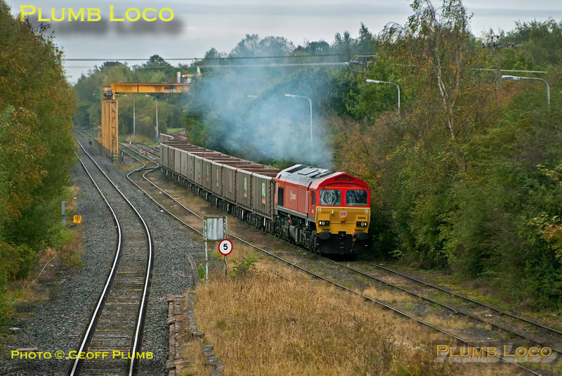 59203 was once again doing the honours with 7Z60 from Merehead Quarry to Calvert on Friday 19th October 2012, this time in miserable weather. Its return as 7Z61 was apparently retimed from 11:05 depart Calvert to 10:35 depart, but in the event it didn't leave until 11:41, with six of its twenty wagons still loaded. The loco makes a smoky start away from the unloading area, heading for the runround in the loop at Claydon L&NE Junction. Digital Image No. GMPI12628.