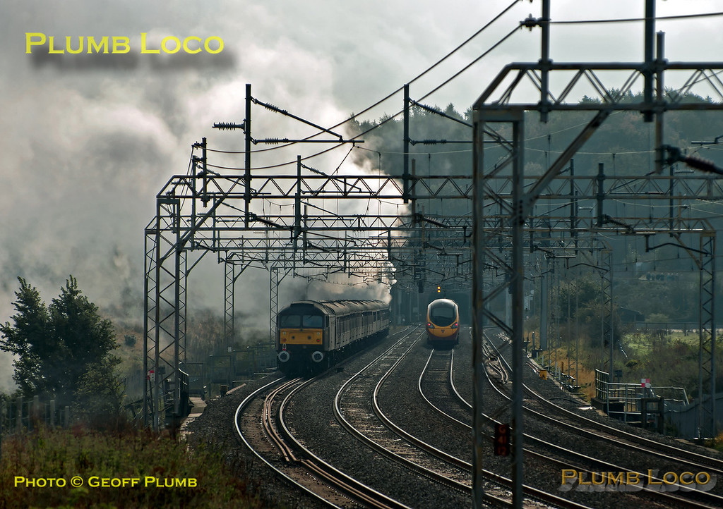 """As 46233 """"Duchess of Sutherland"""" heads south towards Linslade Tunnel with 47854 on the rear of its train, it is overtaken by a southbound Pendolino on the up fast line. The diesel was on the rear of 1Z86, Sheffield to Euston train, which it led as far as the reversal at Nuneaton. 11:41, Saturday 20th October 2012. Digital Image No. GMPI12667."""