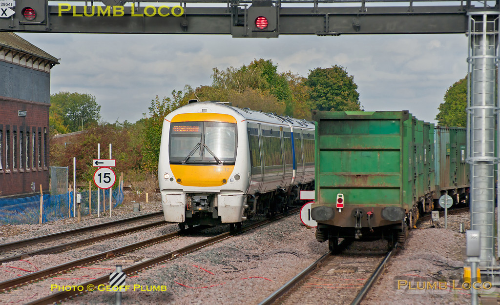 """As the last of the wagons of 6M22, the Cricklewood to Calvert """"binliner"""" take the branch to Aylesbury at Princes Risborough, 168 112 races through southbound on the up main line with 1H34, the 11:12 from Birmingham Snow Hill to Marylebone train. Meanwhile, the RHTT is standing on the down main line - hidden from view here - waiting to follow 1H34 once it has cleared. 12:29, Tuesday 9th October 2012. Digital Image No. GMPI12556."""